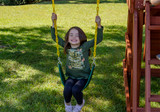 Girl taking a swing on the Five Star Space Saver Play Set from PlayNation