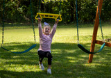 Girl taking a swing on the yellow Trapeze Bar from PlayNation Play Systems.