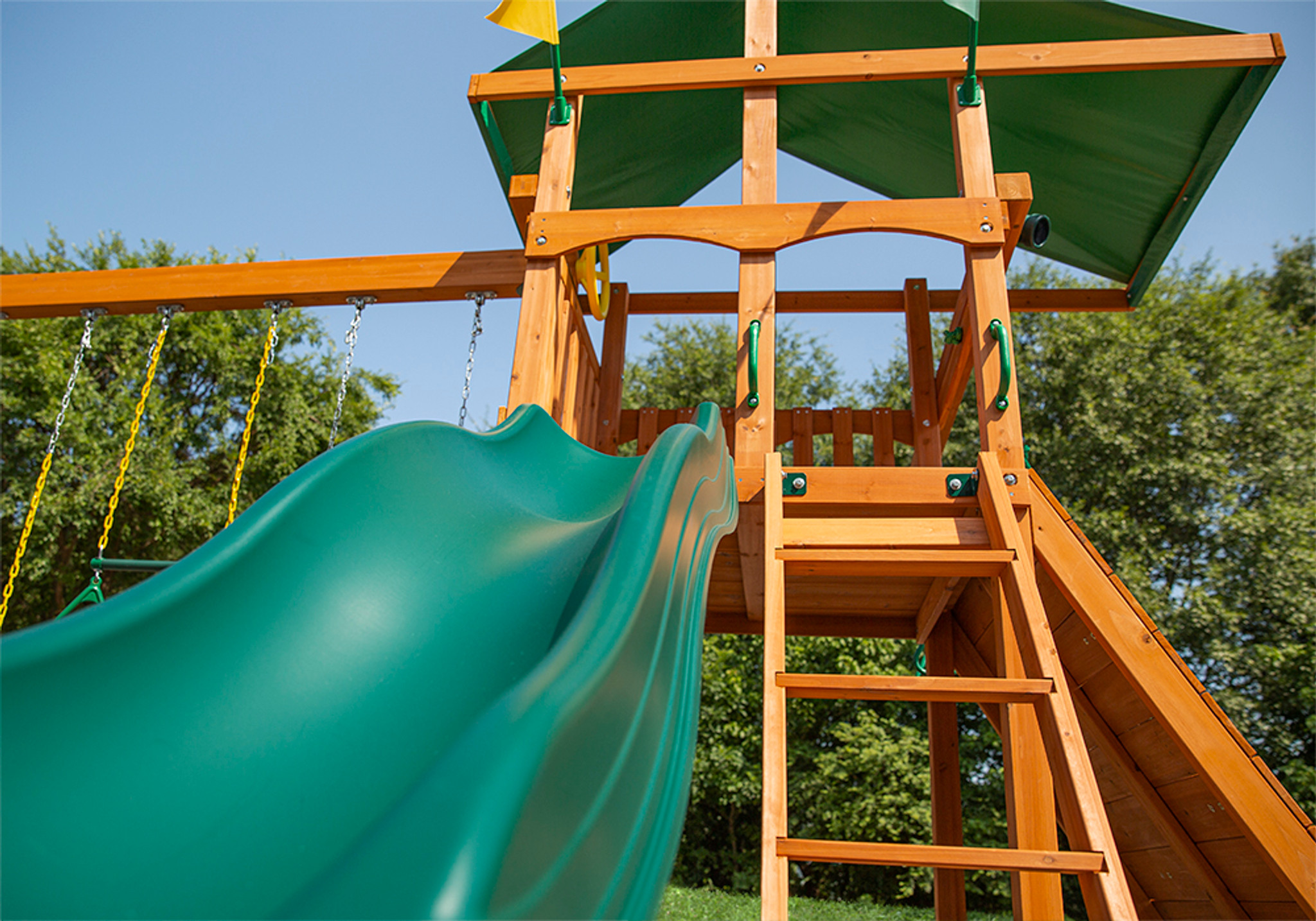 Extreme shot of Outing w/ Trapeze Bar Swingset and Alpine Wave Slide & Safe Entry Ladder from PlayNation