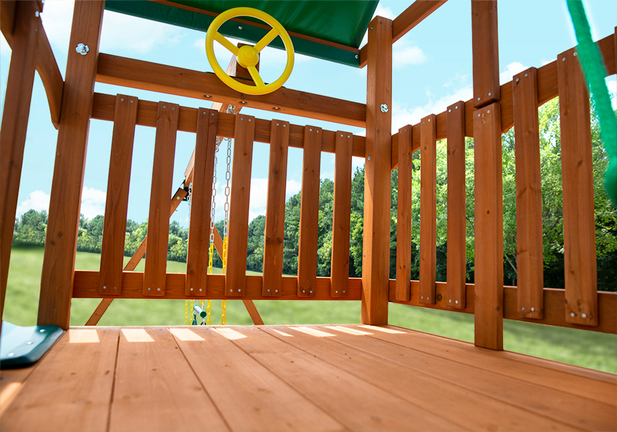 Close up shot of Passage II w/ Trapeze Bar Play Set's Deck and Steering Wheel from PlayNation
