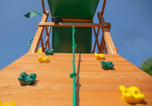Extreme shot of Outing Swing Set and Rock Wall from Playnation