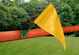 Outdoor shot of yellow Playset Flag Kit from PlayNation.