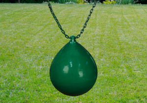 Outdoor shot of green Buoy Ball w/ Chain and Spring Clips from PlayNation.