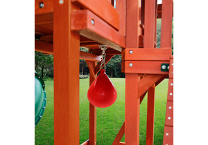 View of the punching bag installed under the deck of the Redbrook Deluxe Swingset from PlayNation