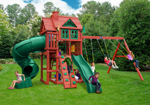 Outdoor front view of Calypso Deluxe Play Set from Playnation play systems.