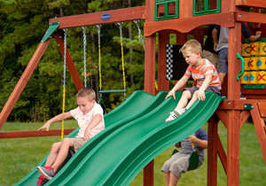 Kids racing on Dual Alpine Wave Slides from Playnation play systems.