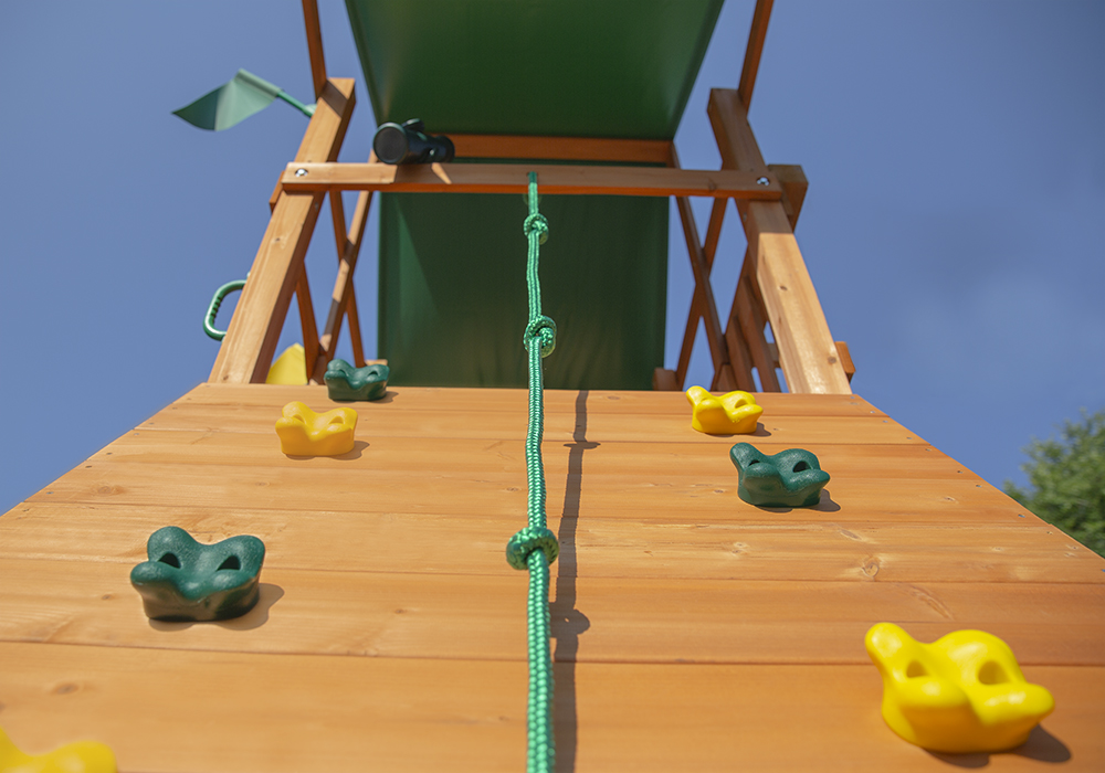 Extreme shot of Passage II Deluxe Swing Set and Rock Wall from Playnation
