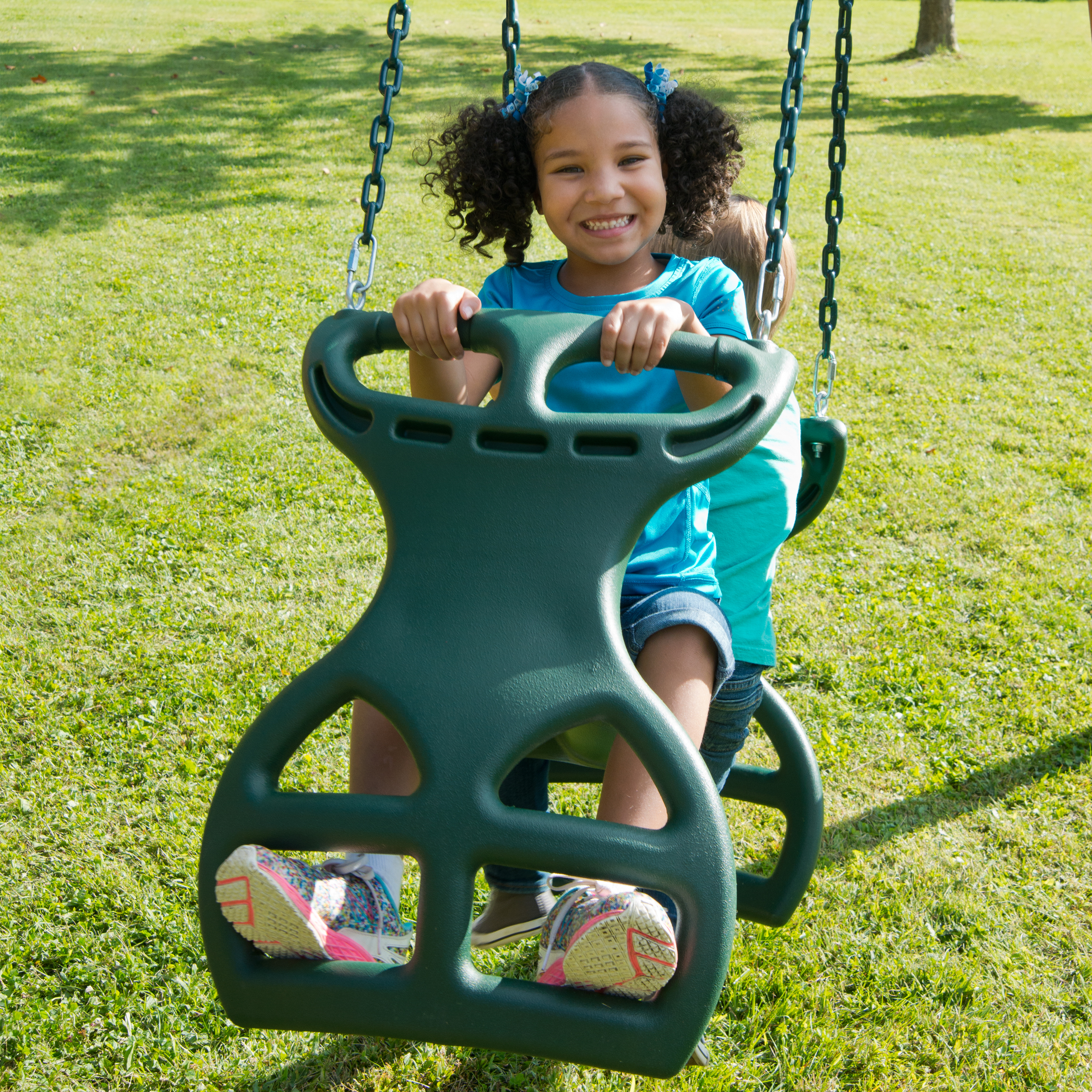 Outdoor shot of Double Glider Swing Swing from PlayNation.