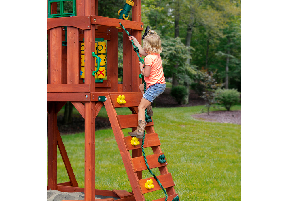 Girl on rock wall with rope ladder from Playnation play systems.