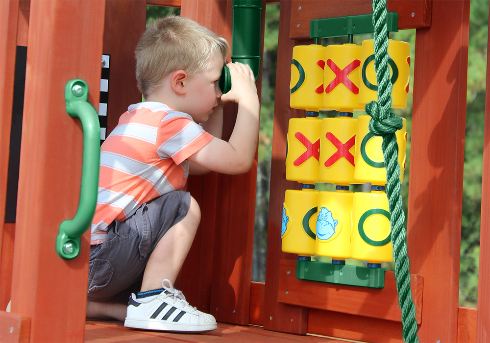 Boy using Play Periscope from Playnation play systems.
