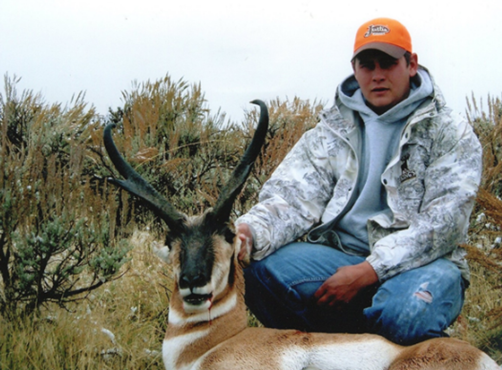 Young guy with a trophy antelope.