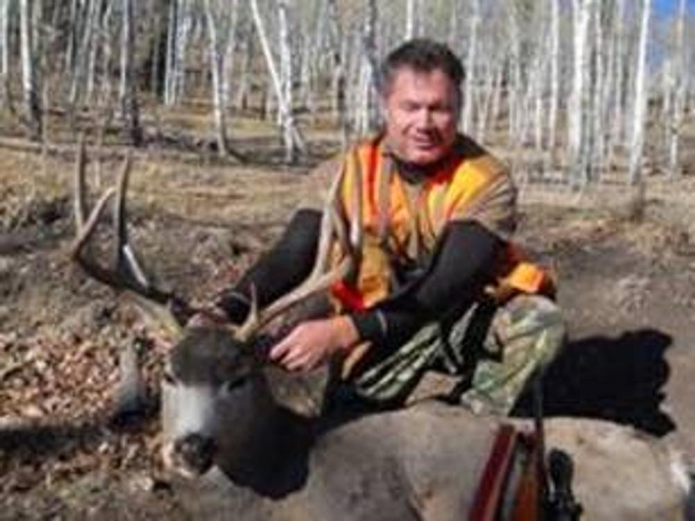 Buck mule deer on private land.