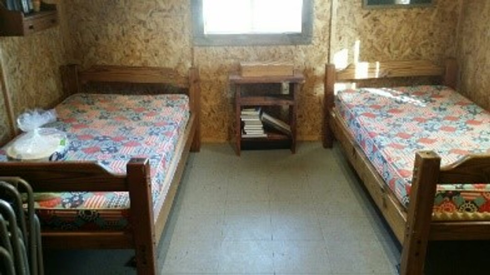 More beds in the hunting cabin.