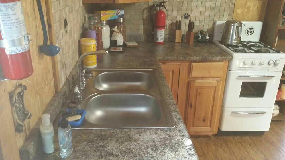 Nice kitchen in hunting cabin.