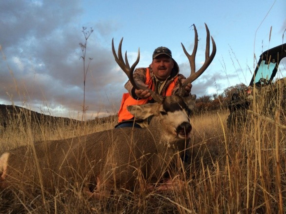 A hunter on his guided hunt for mule deer.