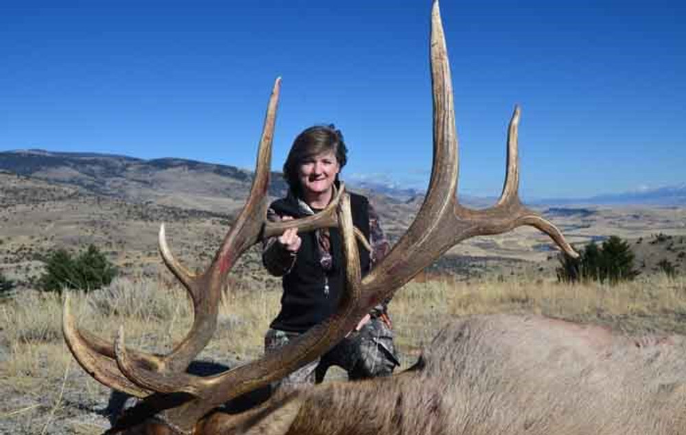 Happy woman with her Wyoming trophy elk.