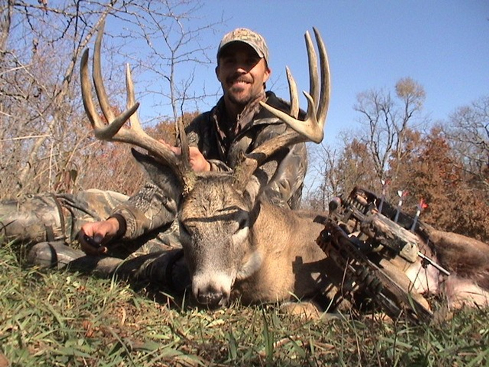 Happy hunt with whitetail buck.