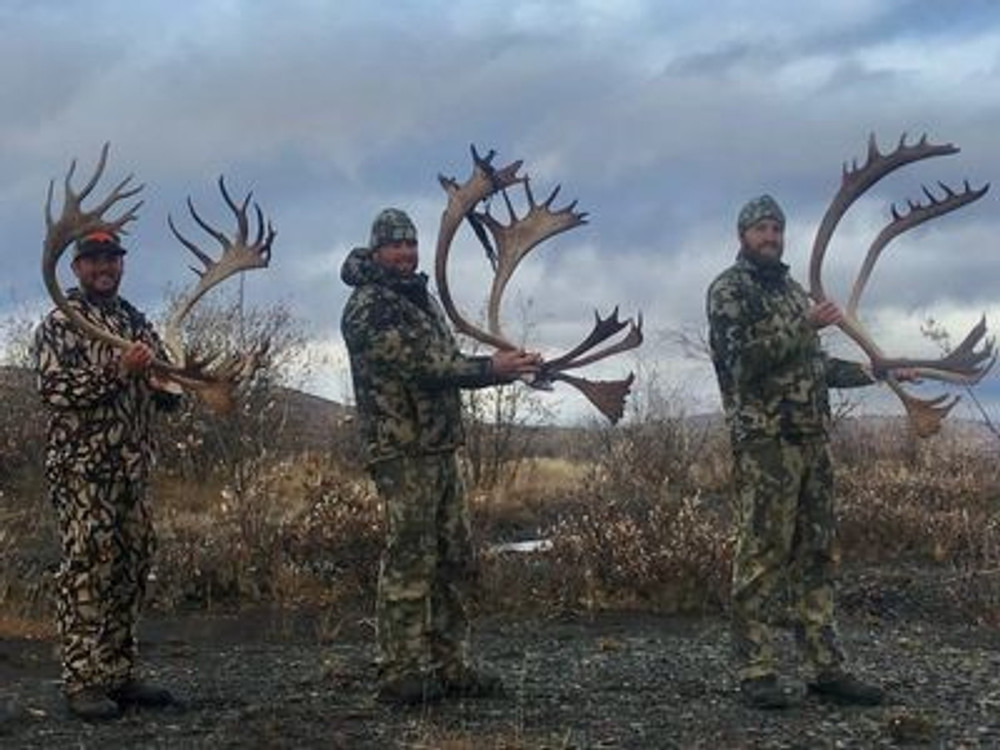 Successful group of caribou hunters