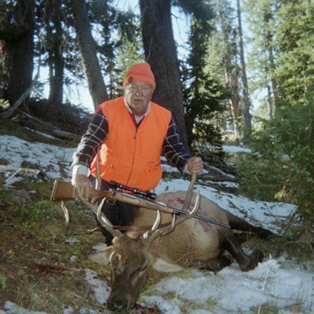 Happy rifle elk hunter.