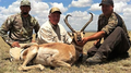 Hunter, buddy and guide with a trophy pronghorn antelope.