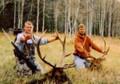 Hunting buddies with trophy elk.