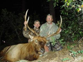 Father and son hunting elk.