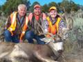 Family hunting mule deer together.
