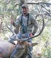 Proud archery hunter with Idaho elk.