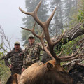 Smiling trophy elk hunter