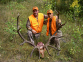 Two buddies happy with a successful elk hunt.