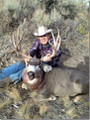 Buck muley and proud hunter.