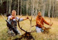 Hunting buddies with trophy elk.