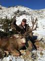 Happy hunter with mule deer trophy