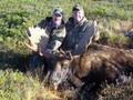 Moose hunter is happy.