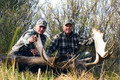 Happy moose hunter and his guide.
