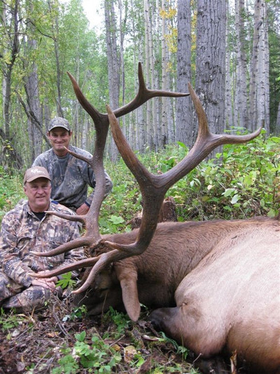 Hunter and his guide and a trophy 6x6 bull.