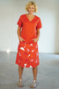 Full length front view with Elle Top Coral untucked
