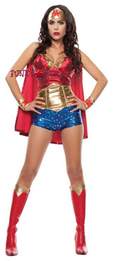 5Sequin top, metallic shorts with stars, gold waist cincher, headpiece, arm cuffs, and cape.5