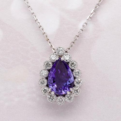 Tanzanite and diamond halo pendant