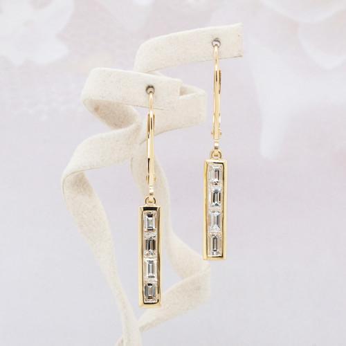 Dangling baguette cut diamond earrings