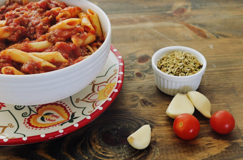 Delicious plant-based Italian sausage in a rich marinara over penne, featuring Beyond Meat® .