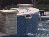 curved fire pit frame in outdoor water feature