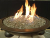 Bronze fire glass in lit fire bowl