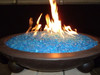 Tropical blue fire glass in lit fire pit