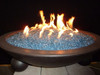 Large arctic blue fire glass in a lit fire bowl