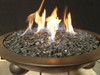 Large black fire glass in lit fire bowl