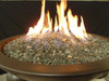 Large bronze fire glass in a lit fire bowl