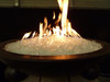 Large diamond fire glass in lit fire bowl