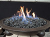 Large gray fire glass in a lit fire bowl