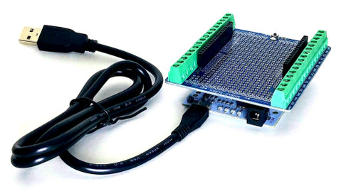 Arduino compatible board with a screw terminal shield and a usb cable.
